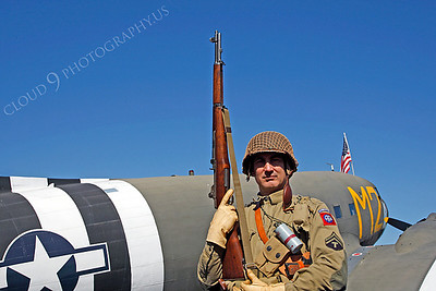 HR - USAWWIIP 00002 A US Army WWII era paratrooper historical reenactor stands by his ride to Nazi Germany by Peter J Mancus