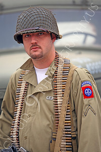HR - USAWWIIP 00033 An airborne re-enactor with an ammo belt, by Peter J Mancus