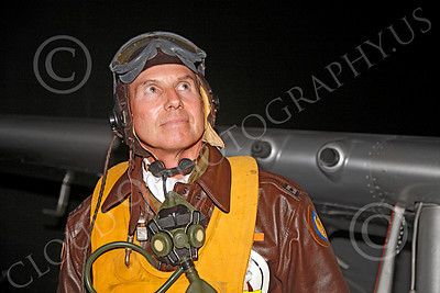 HR - USAAFWWIIAC 00010 A US Army Air Force P-51 Mustang pilot historical reenactor looks up, at night, before an early morning mission, by Peter J Mancus