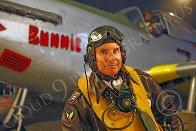 HR - USAAFWWIIAC 00014 A US Army Air Force P-51 Mustang pilot historical reenactor stands before a P-51, at night, before an early morning mission, by Peter J Mancus