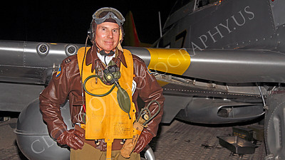 HR - USAAFWWIIAC 00013 A US Army Air Force P-51 Mustang pilot historical reenactor stands before his plane's wing, at night, before an early morning mission, by Peter J Mancus