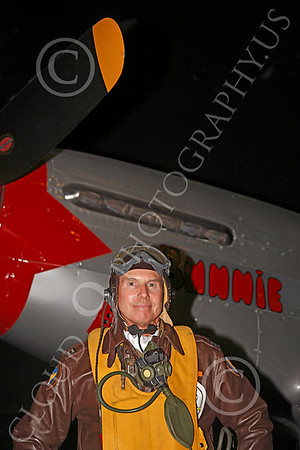 HR - USAAFWWIIAC 00011 A US Army Air Force P-51 Mustang pilot historical reenactor stands near his plane's propeller, at night, before an early morning mission, by Peter J Mancus