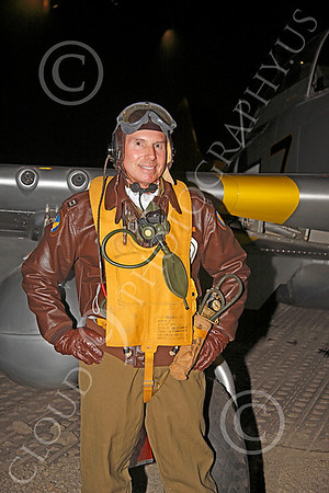 HR - USAAFWWIIAC 00007 A US Army Air Force P-51 Mustang pilot historical reenactor stands before a wing on his plane, at night, before an early morning mission, by Peter J Mancus