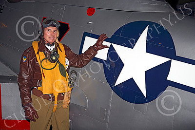 HR - USAAFWWIIAC 00012 A US Army Air Force P-51 Mustang pilot historical reenactor stands by his plane's national insignia, at night, before an early morning mission, by Peter J Mancus