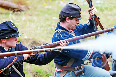 HR-ACWBS 00036 Camera captured a Yankee's musket's yellow core blast, historical re-enactor picture by Peter J Mancus