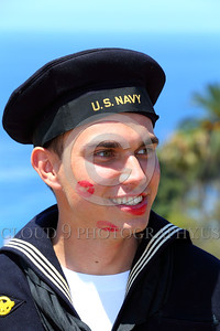 HR-WWIIUSN 00014 This WWII era US Navy sailor historical re-enactor with lipstick underscores well that kisses rejuvente a man and gives him a new zest for life that makes all colors brighter, by Peter J Mancus