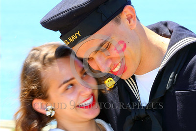 HR-WWIIUSN 00026 The camera captured eternal evidence of Cupid's well aimed arrows as a young US Navy World War II era sailor historical re-enactor relishes happiness with his girlfriend by Peter J Mancus