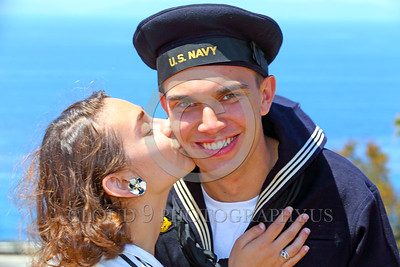 HR-WWIIUSN 00009 A young US Navy World War II era sailor historical re-enactor beems as his girlfriend kisses him, by Peter J Mancus