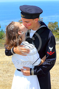 HR-WWIIUSN 00027 A happy US Navy WWII era historical re-enactor sailor kisses his girl, by Peter J Mancus