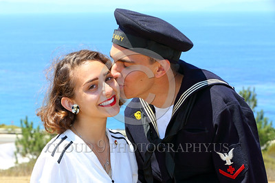 HR-WWIIUSN 00004 A young US Navy World War II era sailor historical re-enactor kisses his beaming girlfriend by Peter J Mancus