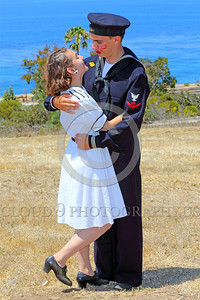 HR-WWIIUSN 00003 A young lady raises his foot as she swoons in love over her adoring young US Navy World War II era sailor boyfriend historical re-enactor by Peter J Mancus