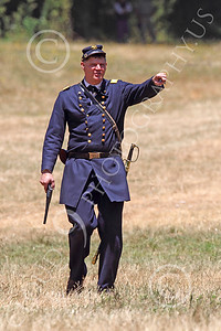 HR-ACWY 00011 An American civil war Yankee officer historical reenactor with a drawn pistol directs his soldiers, by Peter J Mancus