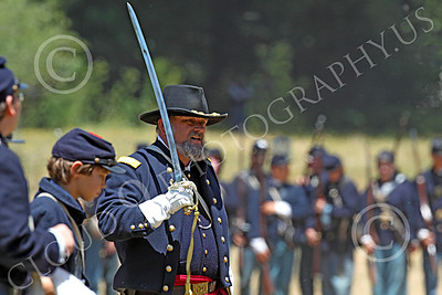 HR-ACWY 00022 An American civil war Yankee officer historical reenactor holds his sword upright, by Peter J Mancus