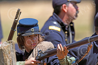 HR-ACWY 00038 A young American civil war Yankee soldier historical reenactor picks a target before drawing a bead to kill a Johnny Reb, by Peter J Mancus