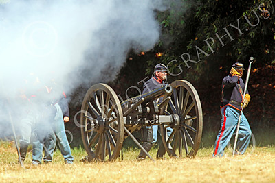 HR-ACWY 00028 Yankee American civil war historical reenactors fire a canon during a simulated battle, by Peter J Mancus