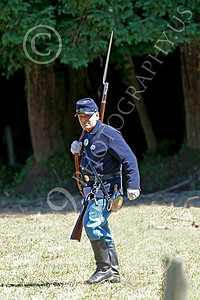 HR-ACWY 00013 An American civil war Yankee soldier historical reenactor with slung musket with a long bayonet walks across a field, by Peter J Mancus