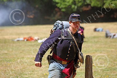 HR-ACWY 00016 An American civil war Yankee soldier historical reenactor hustles to help his buddies, by Peter J Mancus