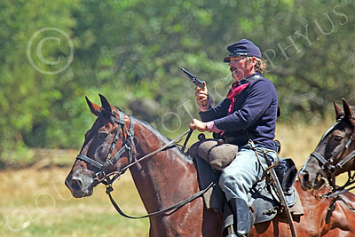HR-ACWY 00030 A mounted American civil war Yankee cavalryman historical reenactor looks at his drawn pistol, by Peter J Mancus