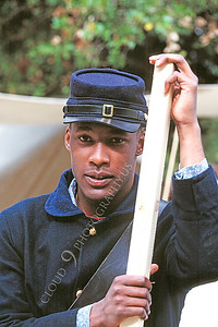 HR-ACWY 00005 A young Black Yankee American Civil War historical reenactor in the midst of work, by Peter J Mancus