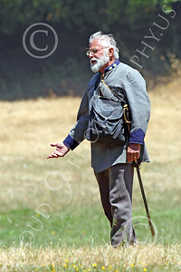 HR-ACWR 00015 A grey beard Confederate officer with a sword and an open right hand in the field, by Peter J Mancus