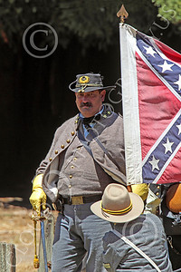 HR-ACWR 00039 A Confederate officer with a sword walks pass a rebel flag, by Peter J Mancus