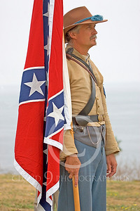 HR-ACWR 00007 An American Civil War Rebel historical reenactor stands by the Confederate flag, by Peter J Mancus