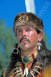 HR-AI 00001 A real American Indian proudly wears authentic Indian clothes, including a grissly bear claws necklace, creating an impressive, convincing reenactment, by Peter J Mancus