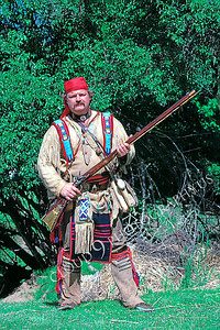 HR-AMM 00003 An American mountain man reenactor holding a rifle poses for a picture, by Peter J Mancus