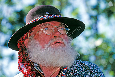 HR-AMM 00002 An American mountain man reenactor with a wonderful beard and old fashioned glasses focuses intently on something, by Peter J Mancus