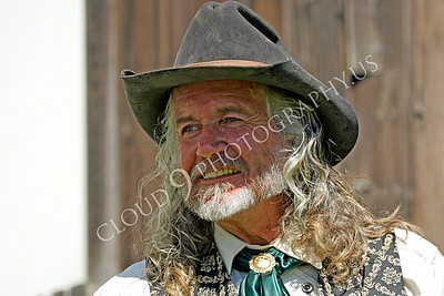 HR - AWGS 00007 An American western gunslinger re-enactor smiles, by Peter J Mancus