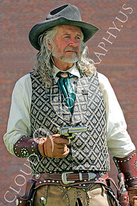 HR - AWGS 00003 American western gunslinger re-enactor with a drawn Colt six-shooter, by Peter J Mancus