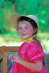 HR-ACWC 00005 American Civil War civilian -- a pretty girl wears a bonnet and a bright scarf and dress, by Peter J Mancus