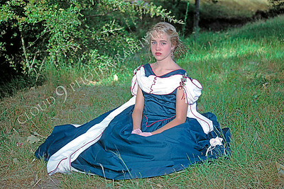 HR-ACWC 00001 American Civil War civilian -- a pretty girl sits on grass in the shade wearing a favorite dress, by Peter J Mancus
