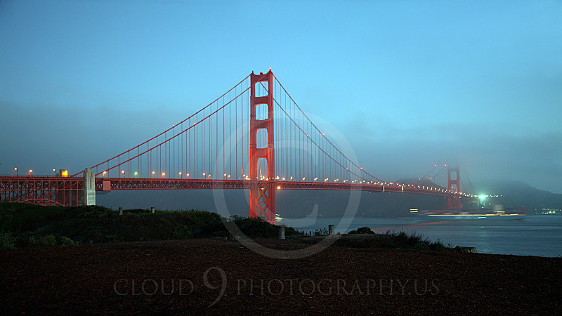 ENGF-GGB 00004A Time elapse exposure of the Golden Gate Bridge at night with a moving cargo ship in lower right corner, by Peter J Mancus