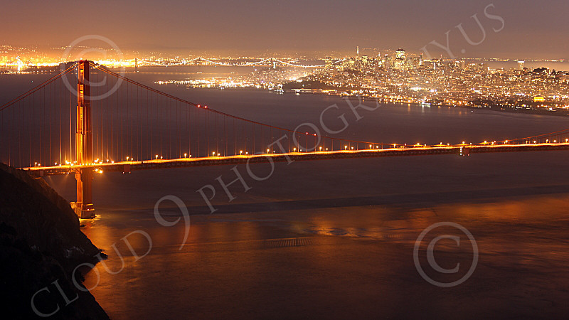 ENGF-GGB 00104 The northern end of the Golden Gate Bridge at night with San Francisco in the background, by Peter J Mancus
