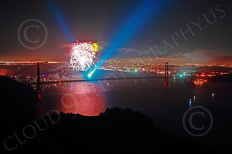 ENGF-GGB 00318 Fireworks and a blue searchlight underscore a Golden Gate Bridge landmark anniversary picture by Peter J Mancus