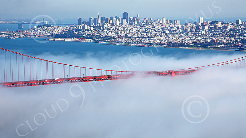 ENGF-GGB 00196 A tight crop of the Golden Gate Bridge's mid span, in fog, with San Francisco in the background, by Peter J Mancus