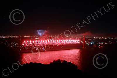 ENGF-GGB 00354 Red fireworks erupt across the entire Golden Gate Bridge during a landmark anniversary celebration picture by Peter J Mancus