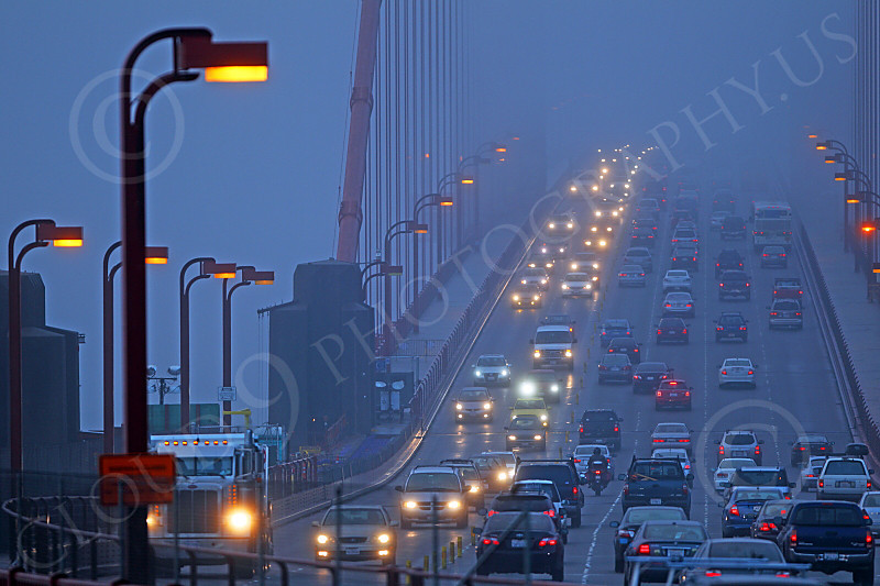 ENGF-GGB 00048 Twilight early morning vehicular traffic on the north end of the Golden Gate Bridge, by Peter J Mancus