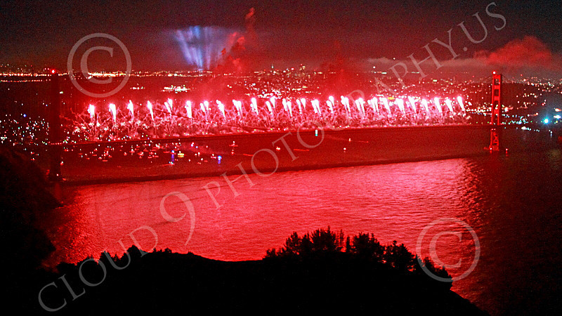 ENGF-GGB 00335 Red fireworks erupt across the entire Golden Gate Bridge during a landmark anniversary celebration picture by Peter J Mancus