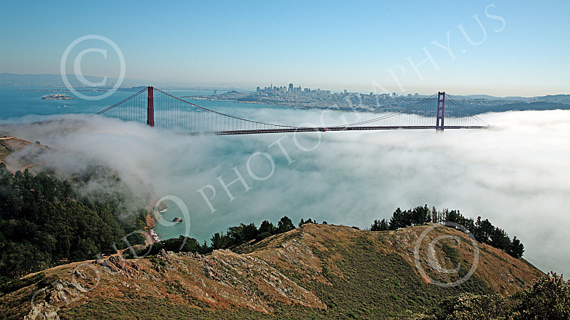 ENGF-GGB 00097 Expansive view of the Golden Gate Bridge in daylight with fog and Alcatraz Island on the left, by Peter J Mancus