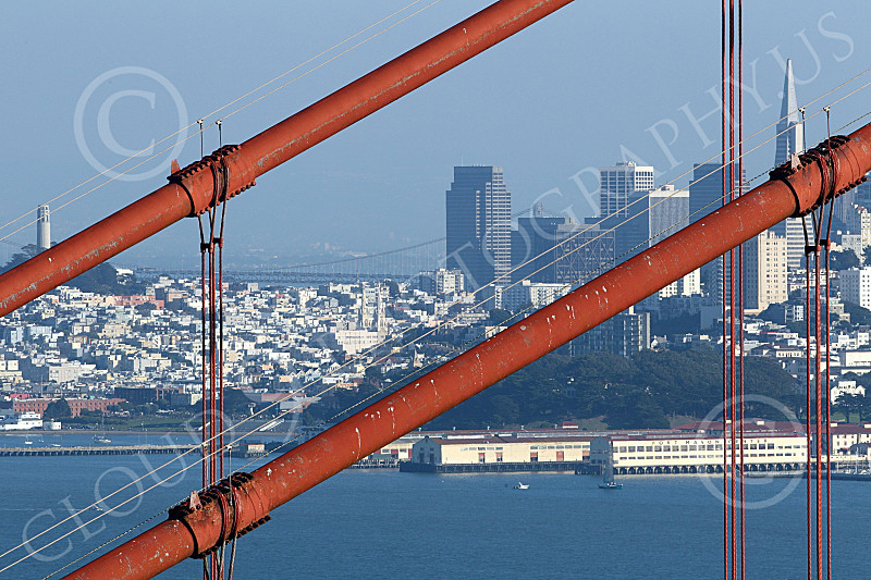 ENGF-GGB 00145 Two major San Fraancisco landmarks behind the Golden Gate Bridge's cables, by Peter J Mancus