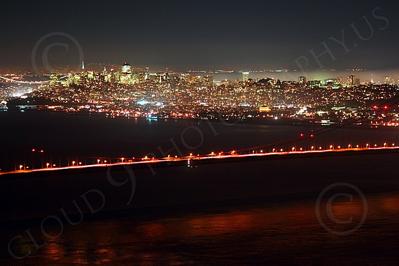 ENGF-GGB 00284 The Golden Gate Bridge's roadway, at night, with San Francisco in the background, by Peter J Mancus