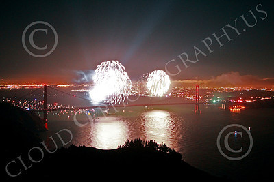 ENGF-GGB 00353 Two large bright white fireworks burst above the Golden Gate Bridge to celebrate a landmark anniversary picture by Peter J Mancus