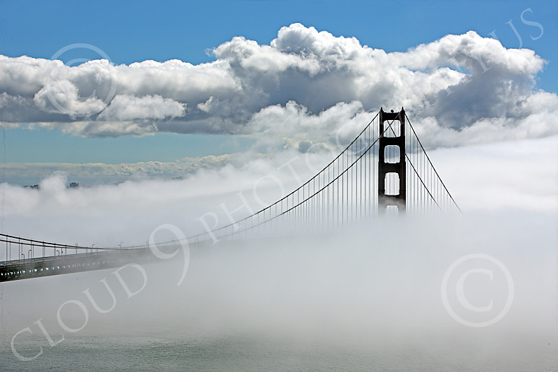 ENGF-GGB 00035 A highlands south view of the south tower of the Golden Gate Bridge amidst fog and clouds, by Peter J Mancus