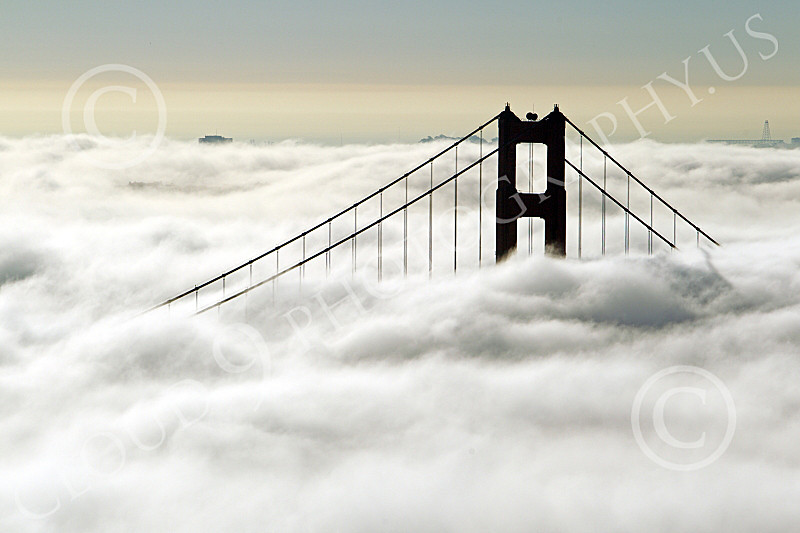 ENGF-GGB 00232 A Golden Gate Bridge tower above thick fog, by Peter J Mancus