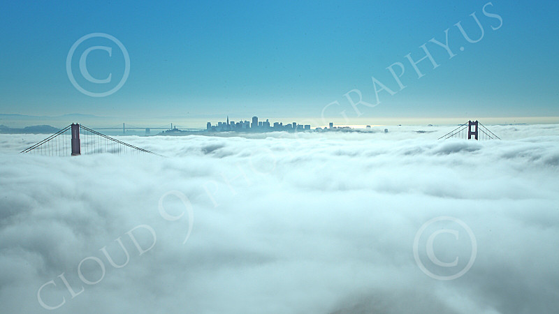 ENGF-GGB 00055 The Golden Gate Bridge's towers' tops remain clear of thick fog, with San Francisco in the background, by Peter J Mancus