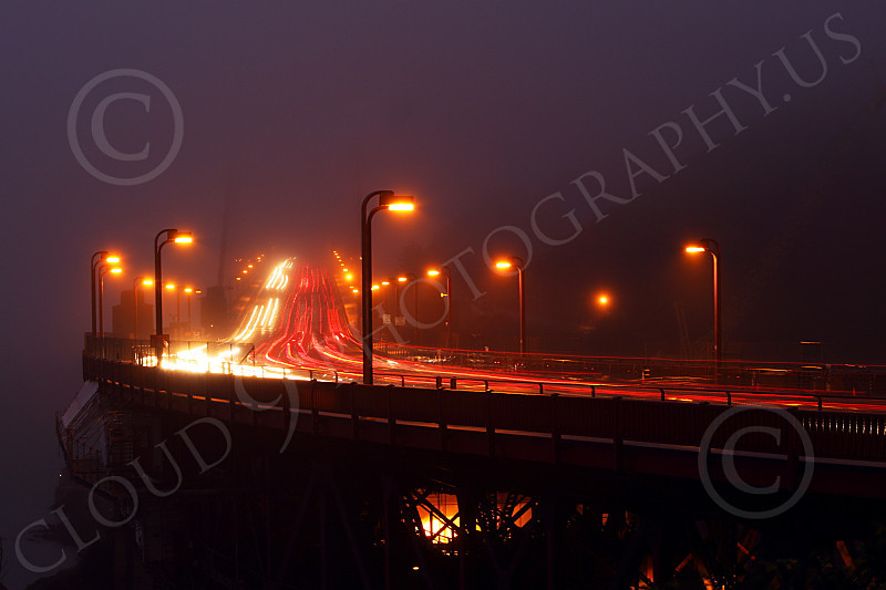 ENGF-GGB 00045 A time lapse picture of night vehicular traffic on the Golden Gate Bridge amidst fog and clouds, by Peter J Mancus