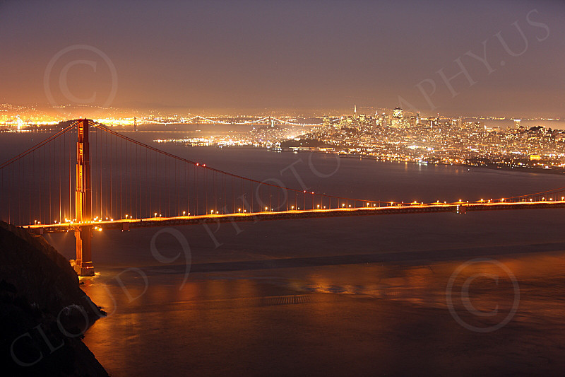 ENGF-GGB 00202 The northern end of the Golden Gate Bridge at night with San Francisco in the background, by Peter J Mancus