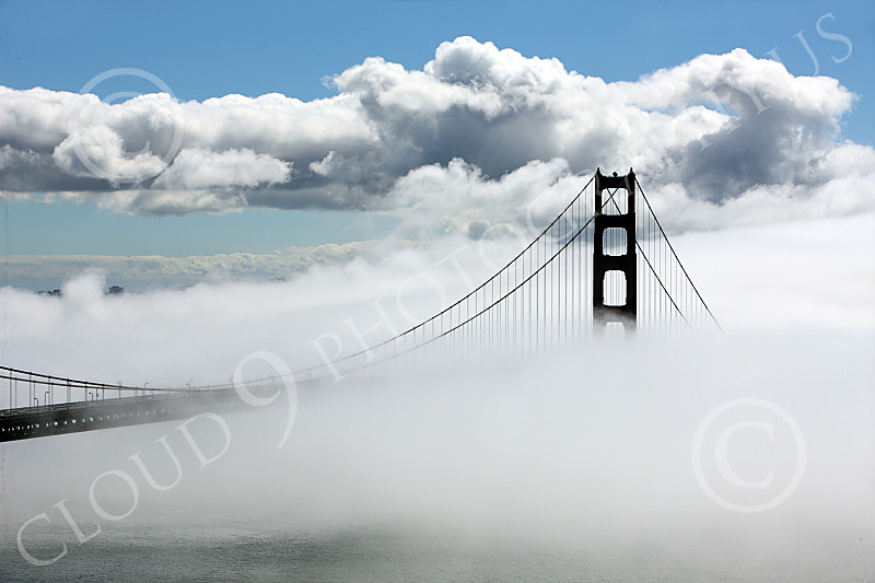 ENGF-GGB 00021 A highlands south view of the south tower of the Golden Gate Bridge amidst fog and clouds, by Peter J Mancus